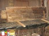 Lato posteriore del battente di portone prima del restauro